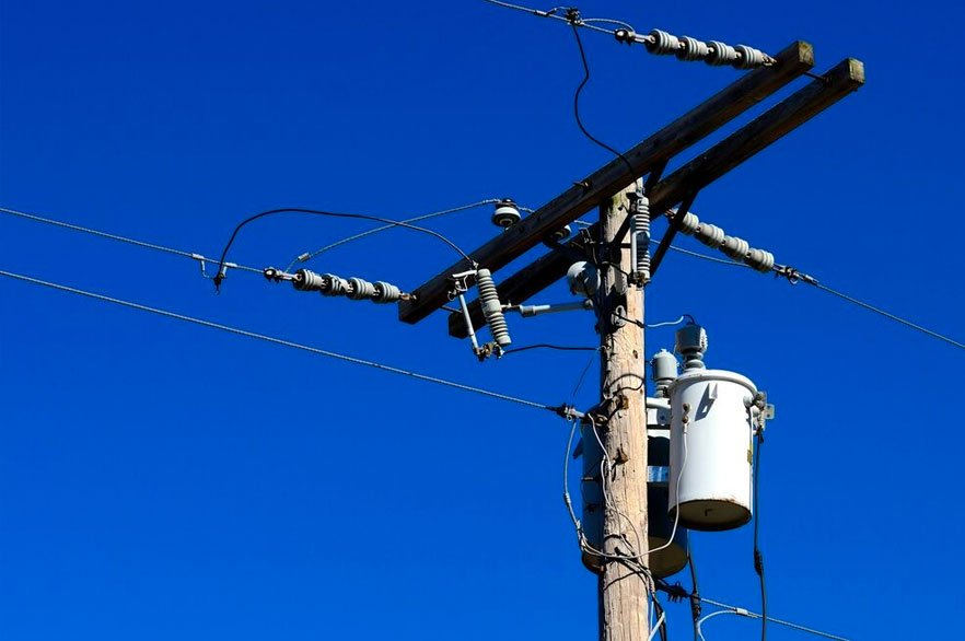 Power lines and power transformer on utility pole