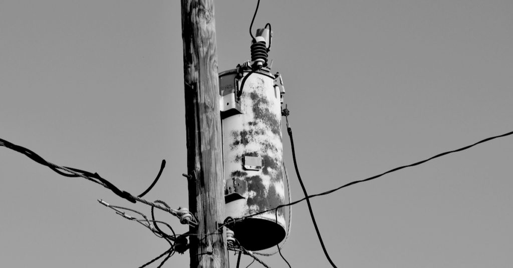 old electrical transformer on pole