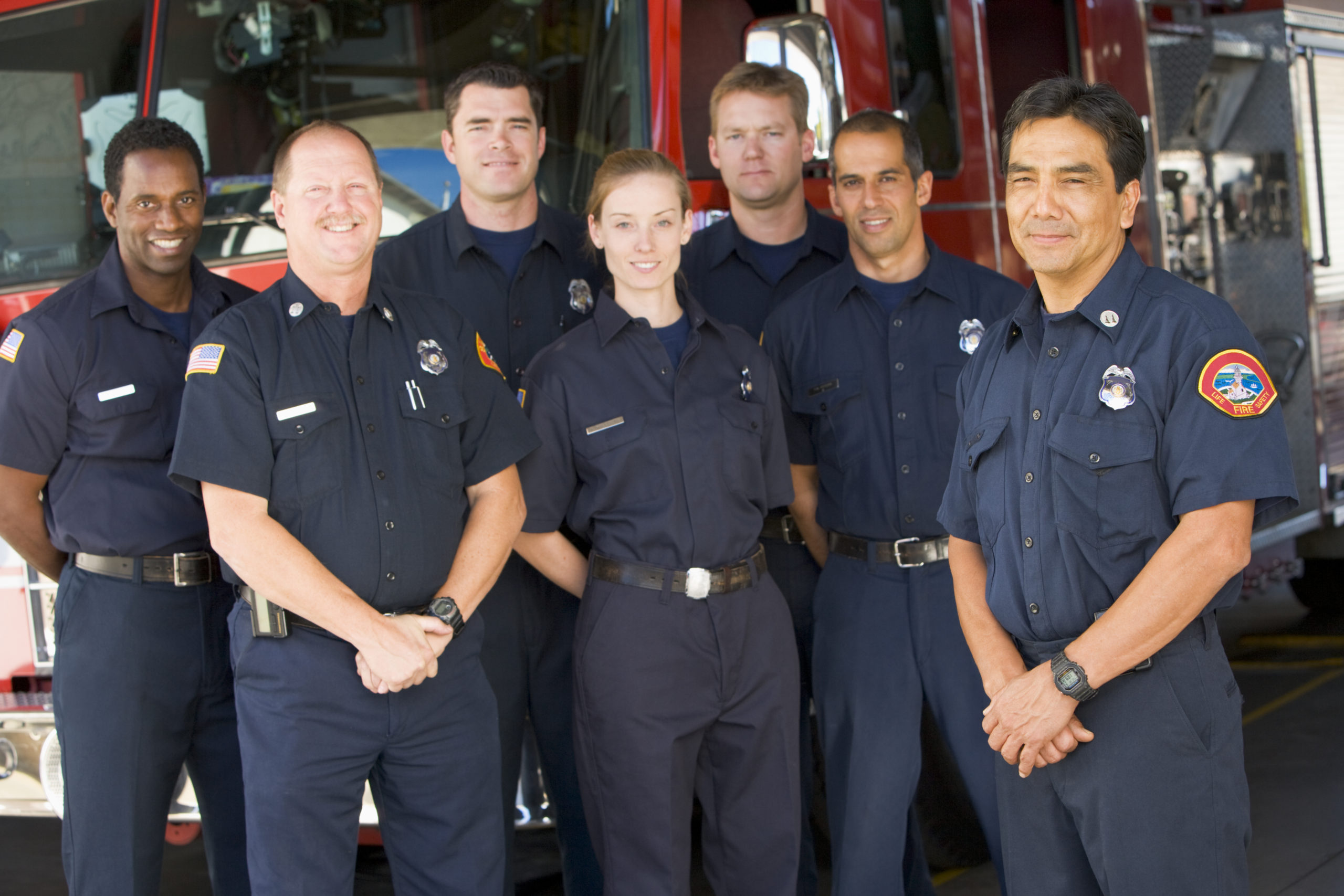 Portrait,Of,Firefighters,Standing,By,A,Fire,Engine